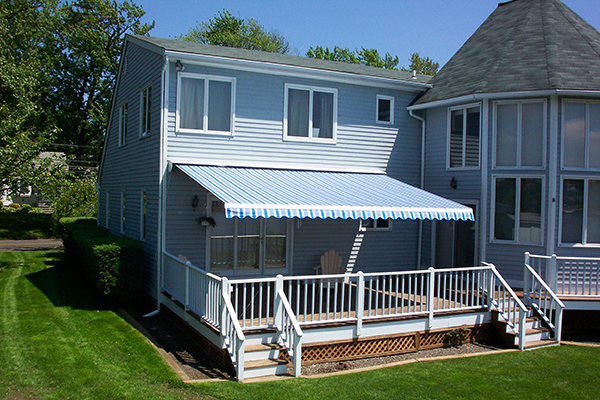 A total home solutions with retractable awnings, motorized awnings, e-zip retractable screens and retractable screen installation